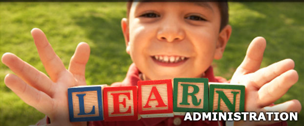 A child holding up building blocks that spell out LEARN, used to represent the Administration Department