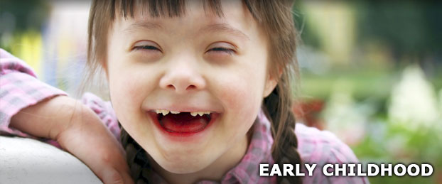 A young girl smiling, used to represent the Early Childhood Department